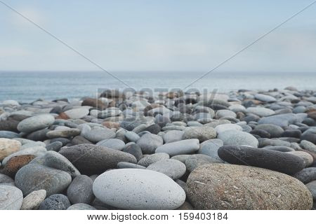 round stones pebble stone beach ocean background