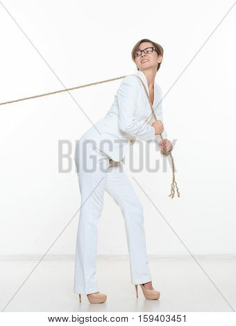 business and education concept - smiling businesswoman pulling rope