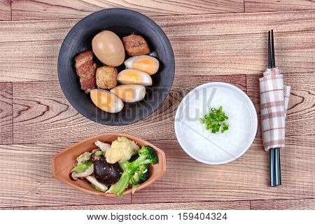 Rice Gruel And Stewed Boiled Egg  And Fried Vegetables.
