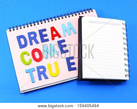 Stock Photo Dream Come True Concept On Notebook Background