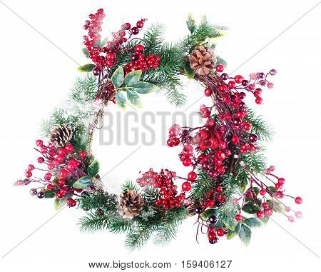 Christmas wreath decoration with snow pine cones and hawthorn berries