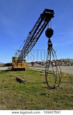 A boom with a cable cage can be used to smash concrete and structure when loaded with weights.