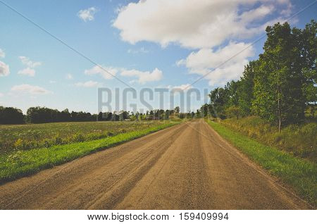 Bright dirt road landscape in the country