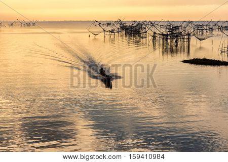 Fishermen thai style fishing trap in Pak Pra Village Phatthalung Thailand.