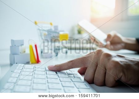 Internet online shopping concept with laptop and shopping-cart.Vintage tone retro filter effectsoft focus(selective focus)