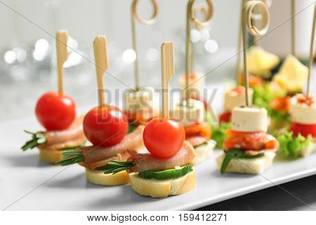 Assorted canapes on table closeup