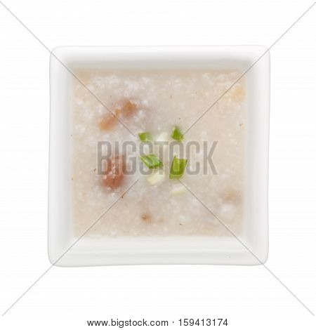 Chinese congee in a square bowl isolated on white background