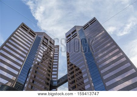 PHOENIX USA - APRIL 23: Upward perspective of new skyscrapers against a blue sky on April 23 2016 in Phoenix Arizona.