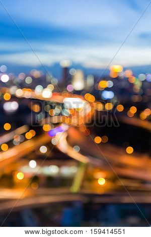 Blurred light highway overpass interchanged with twilight sky background