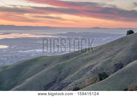 Silicon Valley and Rolling Hills at Sunset. Monument Peak, Ed R. Levin County Park, Milpitas, California, USA.