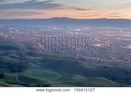 Silicon Valley and Green Hills at Dusk. Monument Peak, Ed R. Levin County Park, Milpitas, California, USA. South-West views of San Francisco South Bay and Santa Cruz Mountains with Green Hills of Santa Clara Valley.