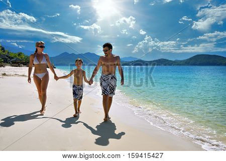 The European family relaxing on the white sandy beach in Asia.