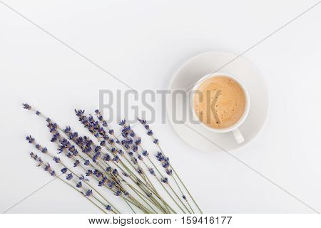 Coffee and lavender flower on white table from above. Woman working desk. Cozy breakfast. Mockup. Flat lay style.