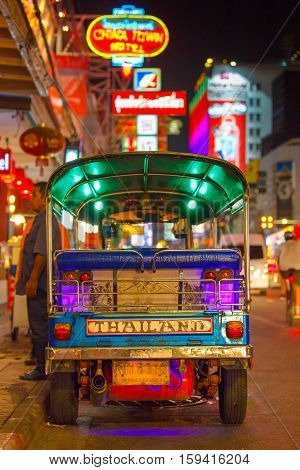 CHINATOWN BANGKOK THAILAND - 12 APRIL 2016: Tuk tuk taxi parked near street market in Chinatown on Yaowarat road the main street of China town.