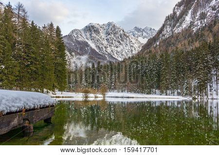 Aerial: Beautiful And Clear Jezersko Lake With Amazing Mountain Background At Winter