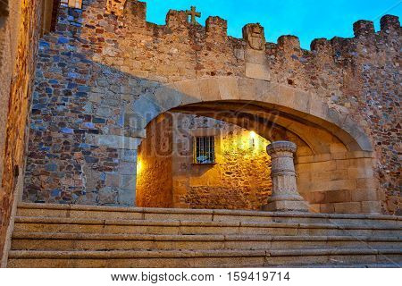 Caceres Arco de la Estrella Star arch sunset in Spain entrance to monumental city image shot from the public floor