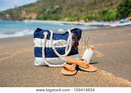 Beach Bag, Flip Flops, Sunscreen And Sunglasses