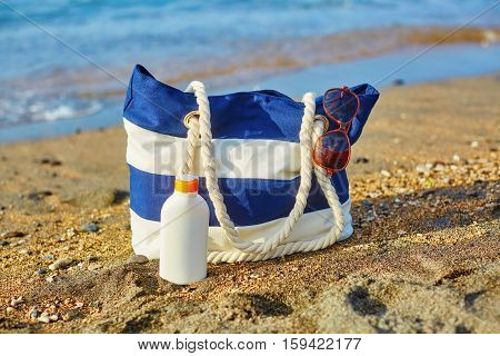Beach Bag, Sunscreen Bottle And Sunglasses