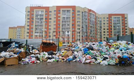 Russia, Leningrad oblast - April 27, 2016: A huge garbage dump on the residential quarter. Environmental disaster of the 21st century