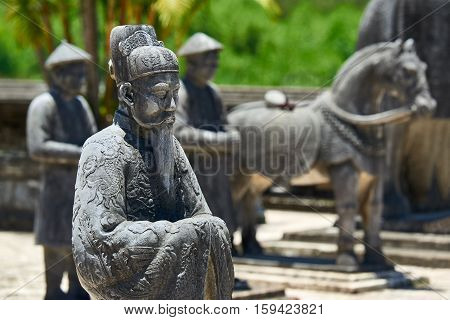 Old statues guardians at the Imperial Tombs of Khai Dinh in Hue. Vietnam