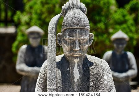 old statues guardians at the Imperial Tombs of Khai Dinh in Hue.Vietnam