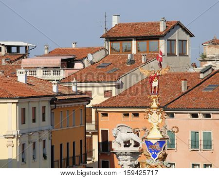 Houses Of The City Of Vicenza And The Tip Of The Sculpture Calle