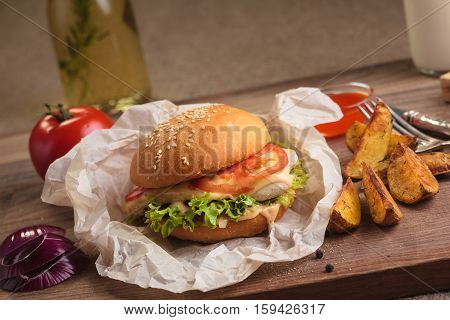 Classic Burger With Chicken And Potato Wedges