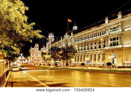 The Calle De Alcala And The Cybele Palace (palacio De Cibeles) On The Cybeles Square In Madrid At Ev
