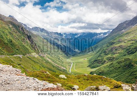 beautiful mountain landscape in summer time road through the mountains Alps Switzerland
