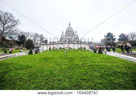 PARIS, FRANCE: MARCH 16, 2015 : Tourist visiting the famous church, Basilica Sacre Coeur in Paris, France on March 16, 2015
