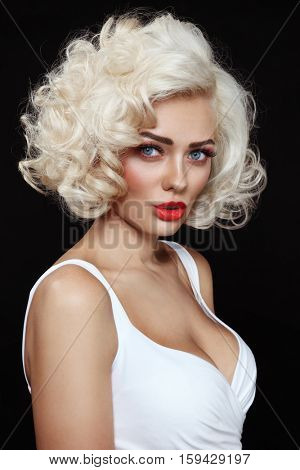 Vintage style portrait of young beautiful glamorous woman with platinum blonde curly hair
