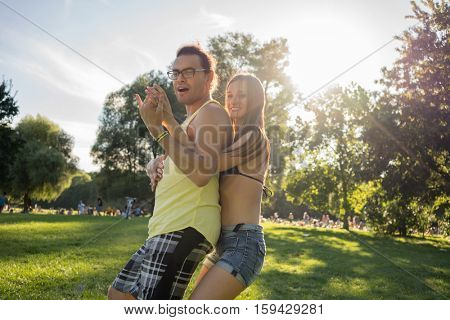 Woman and man dancing salsa in summer park