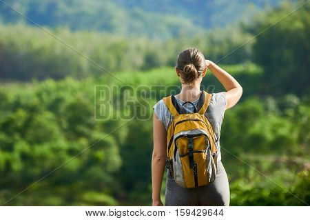 Young woman backpacker traveling along green mountains happy female walking in the island to Tablas discovering world summer vacation concept