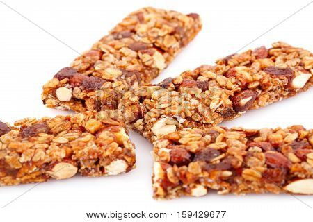 Cereal bars with different nuts isolated on white background.