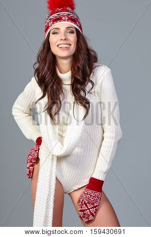 Winter fashion. woman wearing fashionable wintertime clothes white fur scarf, woolen cap .