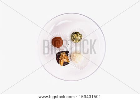 Serving Of Decorative Petit Fours And Bonbons