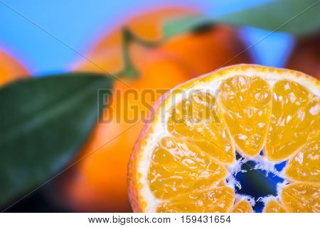 tangerine slice on wooden background macro and closup