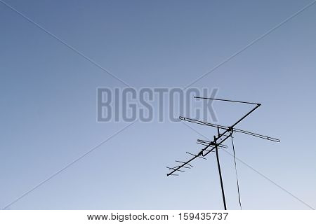 Television Antenna Set Against A Blue Sky.