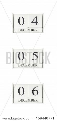 Closeup group of white wooden calendar with black 4 5 6 december word three date calendar isolated on white background
