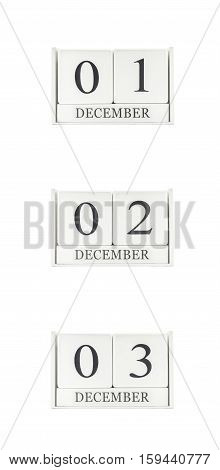 Closeup group of white wooden calendar with black 1 2 3 december word three date calendar isolated on white background