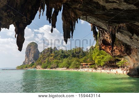 Rocky beach landscape under a huge cave in the Krabi province, Thailand