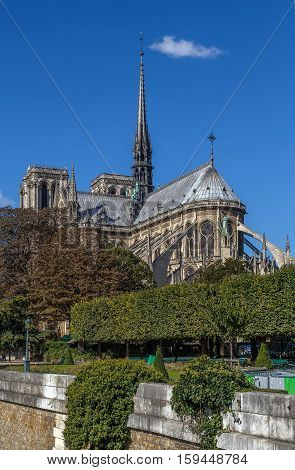 Notre-Dame de Paris is a medieval Catholic cathedral in Paris. View of cathedral choir from Seine bridge