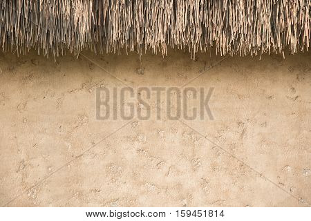 Straw Thatched Roof  And  Soil Wall Background