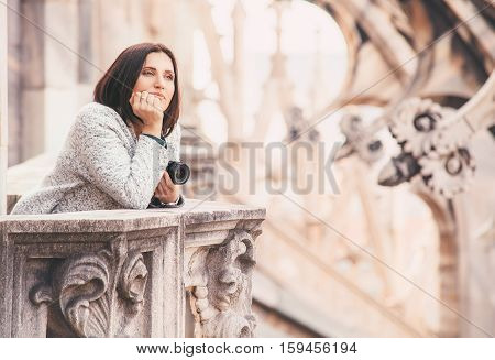 Tourist woman enjoy with calm atmosphere on the roof of Milano Cathedral (Duomo)