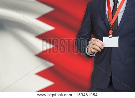 Businessman Holding Name Card Badge On A Lanyard With A National Flag On Background - Bahrain