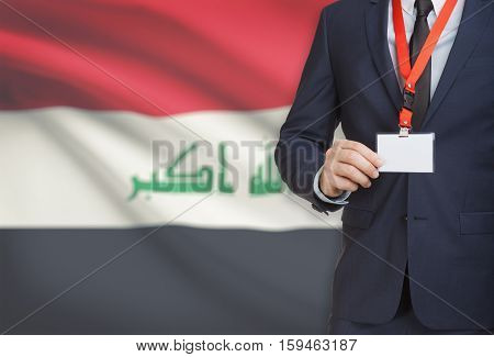 Businessman Holding Name Card Badge On A Lanyard With A National Flag On Background - Iraq