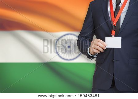 Businessman Holding Name Card Badge On A Lanyard With A National Flag On Background - India