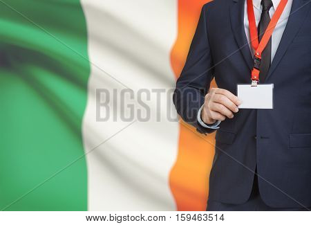 Businessman Holding Name Card Badge On A Lanyard With A National Flag On Background - Ireland