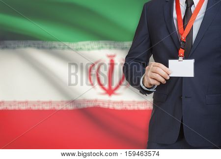Businessman Holding Name Card Badge On A Lanyard With A National Flag On Background - Iran