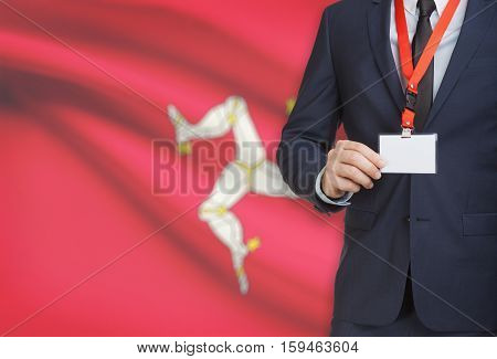 Businessman Holding Name Card Badge On A Lanyard With A National Flag On Background - Isle Of Man